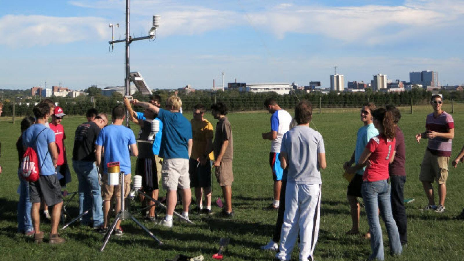 Students, of Microclimatology 5922, in action setting up a weather instruments tower